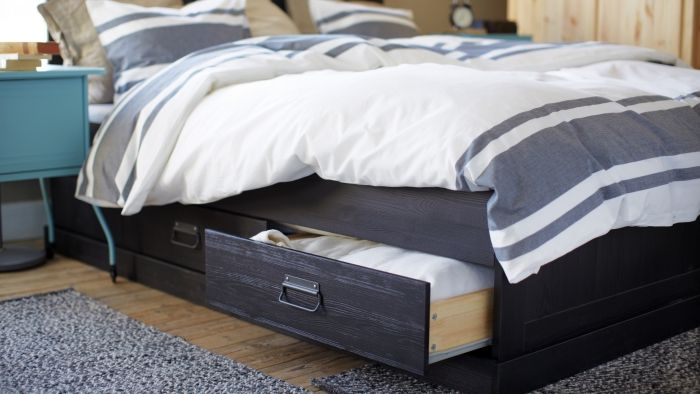 Maximize the space in your bedroom with a storage bed, like FJELL.