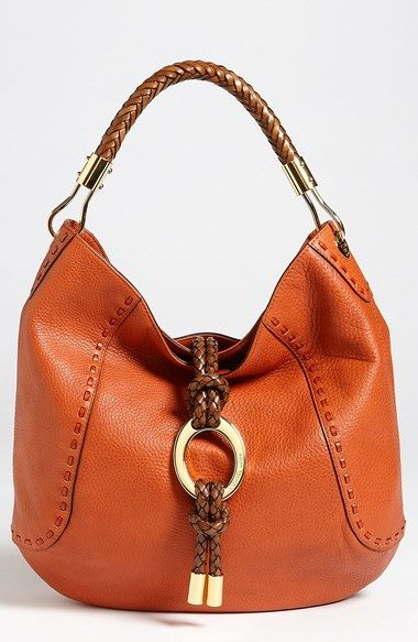 Free shipping and returns on Michael Kors 'Skorpios' Leather Hobo at Nordstrom.com. Tight-woven leather handle and trim lend chic textural contrast to a pebbled-calfskin hobo illuminated with touches of logo-embossed goldtone hardware.