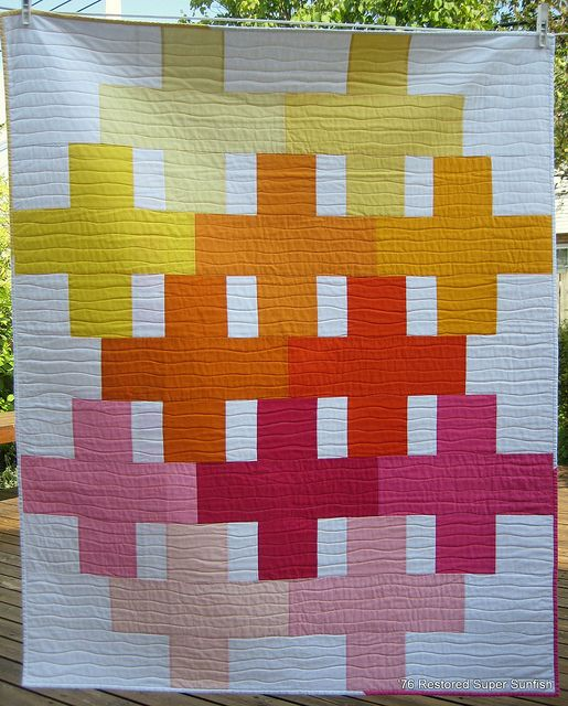 Modern quilt made from solid fabrics. Quilting is perfect for design.