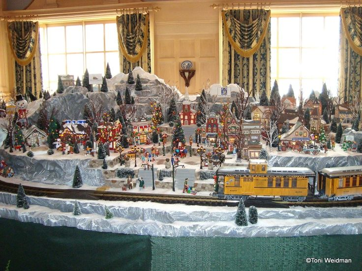 This beautiful snowy village and miniature train is part of The Yacht Club resort's Christmas decorations