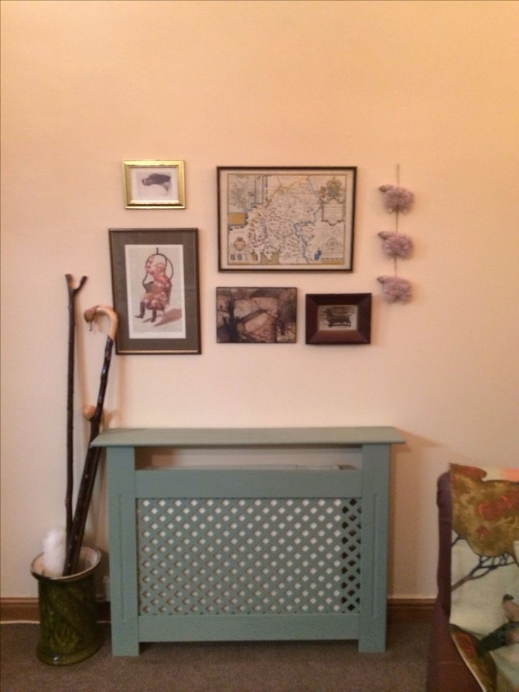 Picture wall :) really pleased with the look painted radiator covers so shield our eyes from ugly storage heaters
