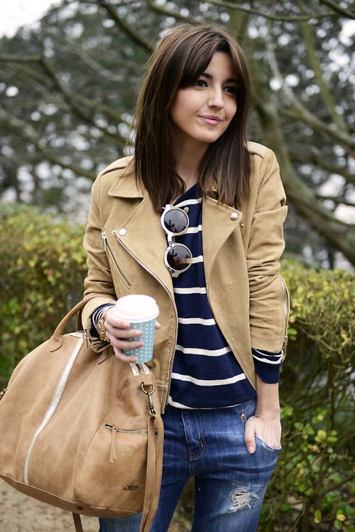 Pairing a tan suede moto jacket with blue destroyed slim jeans is a comfortable option for running errands in the city.  Shop this look for $206:  http://lookastic.com/women/looks/biker-jacket-and-skinny-jeans-and-crew-neck-sweater-and-tote-bag-and-watch/3086  — Tan Suede Biker Jacket  — Blue Ripped Skinny Jeans  — Navy and White Horizontal Striped Crew-neck Sweater  — Tan Leather Tote Bag  — Gold Watch