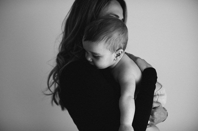 Photograph of Mother holding Baby in her arms // Baby Photography in Melbourne by Kristen Cook // www.kristencook.com.au