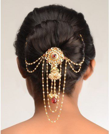 Decorate a bun with hair jewelry! Looks like a bun stick or hair jaw with draping chains and hair combs.