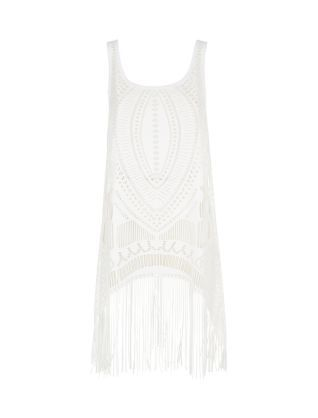 This White Crochet Tassel Hem Dress is the perfect beach cover-up and doubles as an evening dress - just wear a vest tunic underneath.