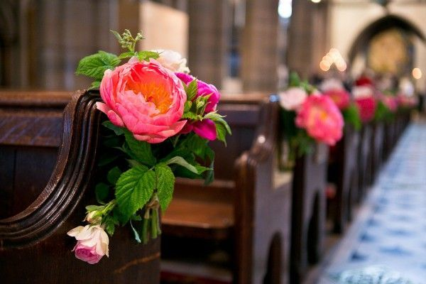 Lush pink flower markers on church pews | photography by http://oneandonlyparisphotography.com/blog/ and http://www.lesecretdaudrey.com/