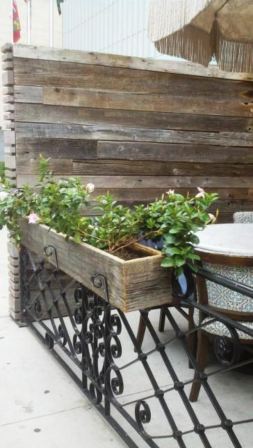 Soho house outdoor privacy screen and planters made with for Outdoor privacy screen planter