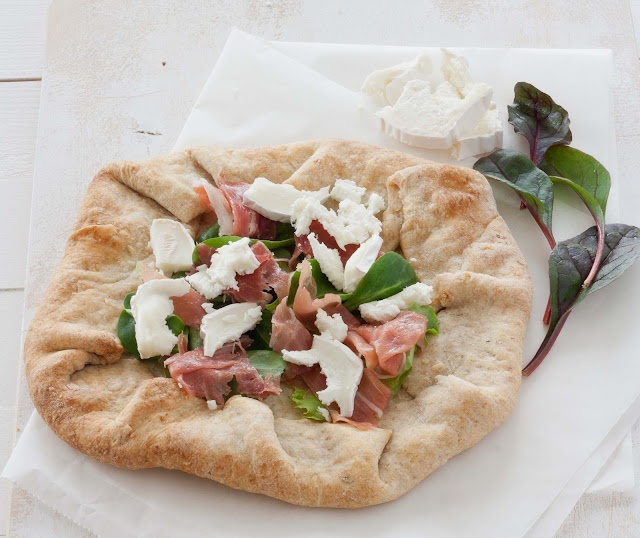 Whole wheat galette with goat cheese, ham and arugula.