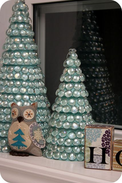 DIY- Cool holiday Christmas trees made with glass bowl fillers for flower arrangements.