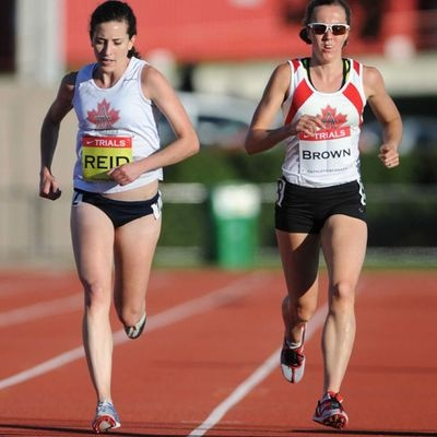 Megan Brown (right) of Puslinch and Sheila Reid of Newmarket race in the women's 5,000 metres final at the Canadian Olympic and Paralympic track and field trials