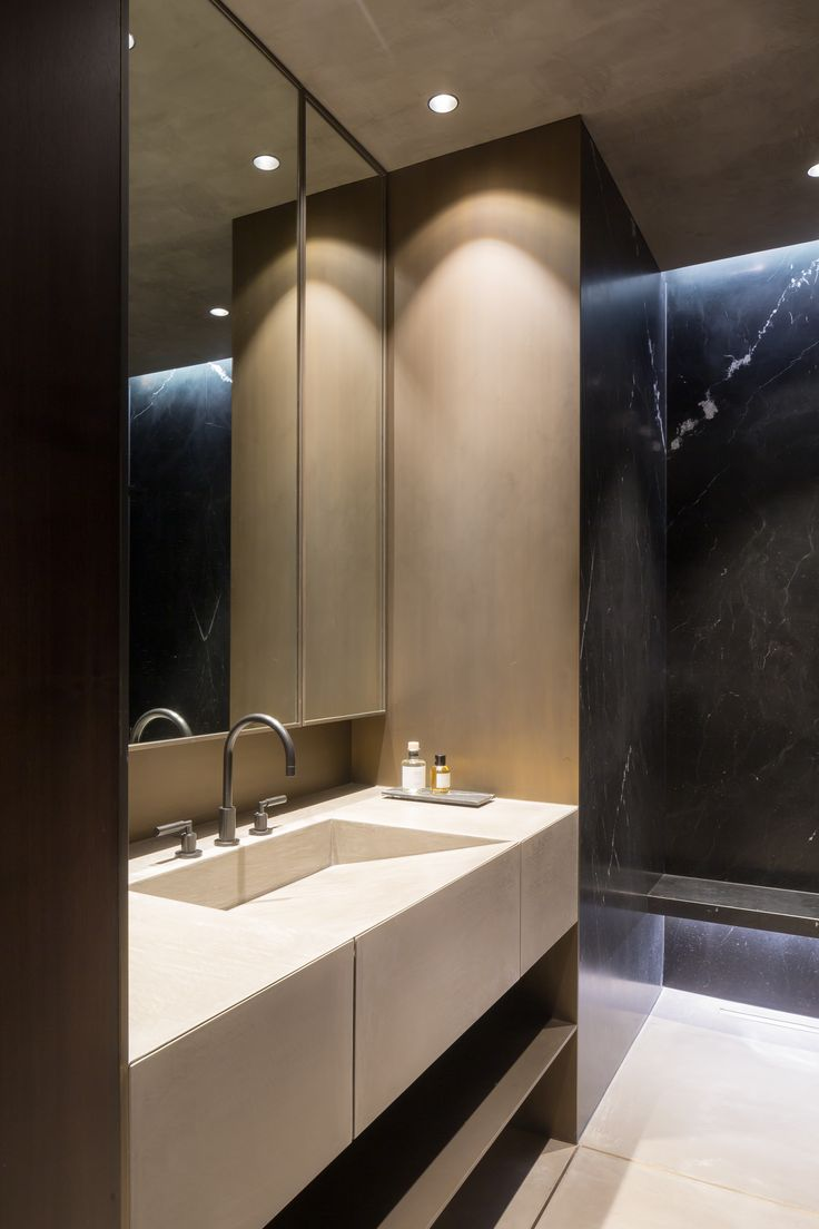 Antwerp Loft / by Dieter Vander Velpen Architects (Photo: Thomas De Bruyne) - black Nero Marquina Marble - patinated bronze - walnut veneer and Mortex