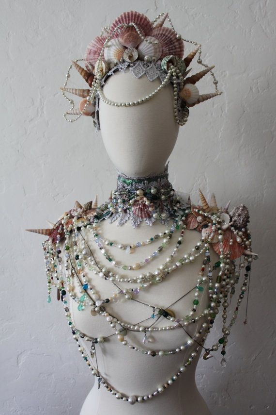 Regal and enchanting. A one of a kind collar of antique shells, draping vintage pearls, antique chains, bijou and lace. The shells and pearls are supported with an under collar of leather and leather epaulettes. The draping necklaces are made up of a wild collection of pearls, drilled sea