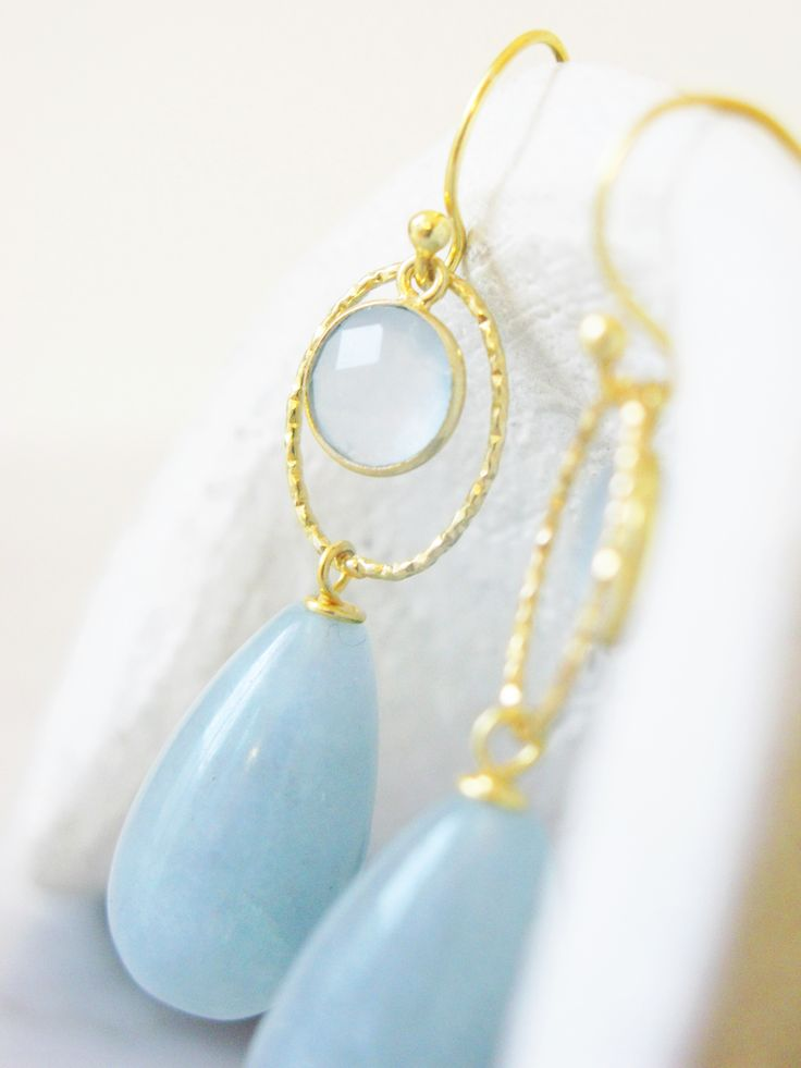 Beautiful handmade earrings, perfect for a garden party or lovely spring picnics. The soft blue tones from the angelite stone and pastel coloured quartz combine wonderfully with the gold details, and are the perfect spring palette!