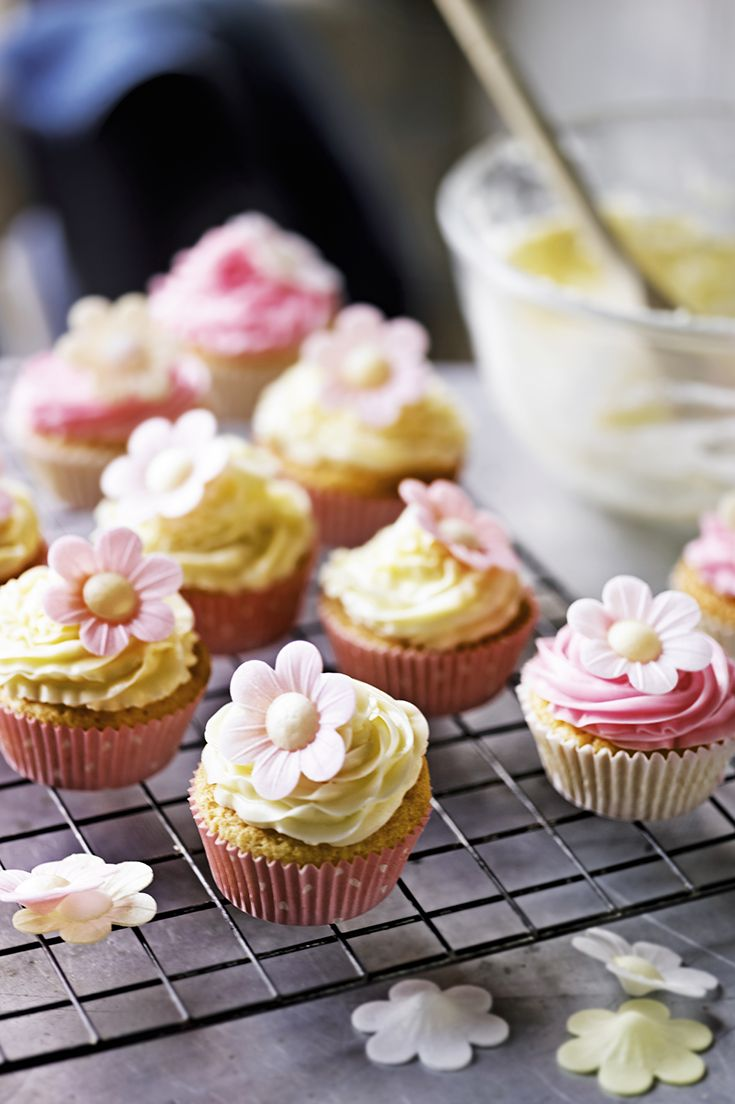 Pretty and cute fairy cakes with thick buttery icing - perfect for afternoon tea for Mother's Day. Find more Waitrose cupcake recipes at www.waitrose.com/recipes