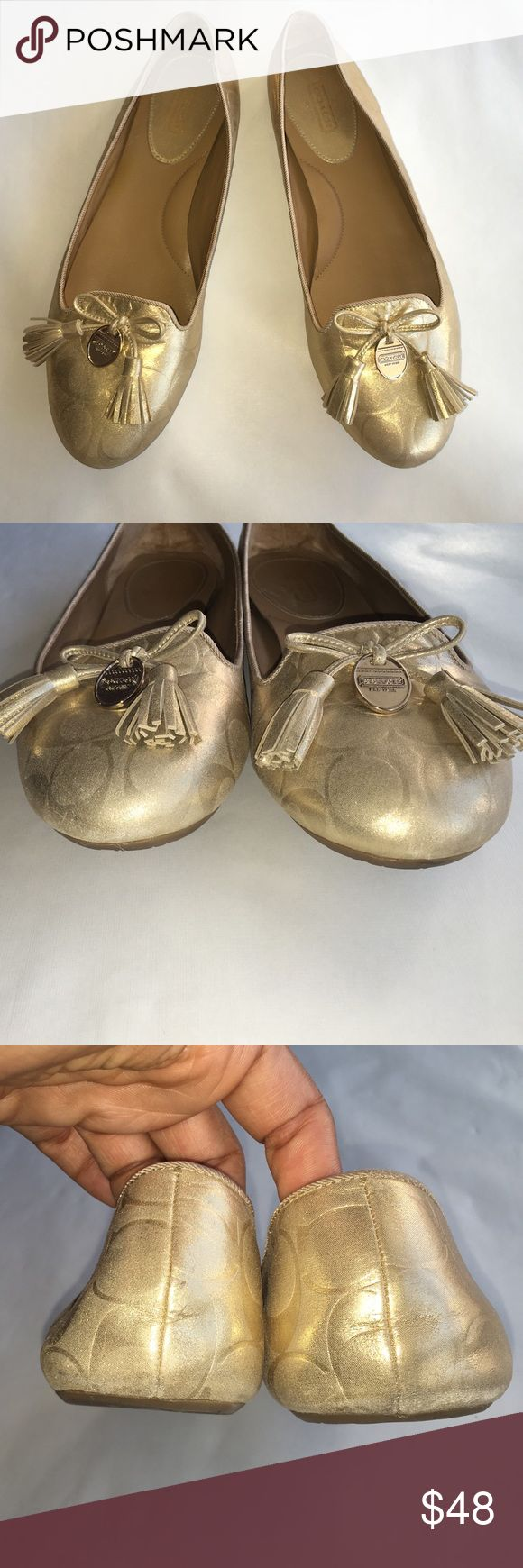 Coach flats Coach Dahlila metallic gold flat with fringe bow and medallion charm on the foot. Great condition with minor wear of the material on the toes and heels (per pic 2-3). Nothing to cry about. Still have a lot of life left. These are medium width. True to size. Perfect for the fall approaching!!! Coach Shoes Flats & Loafers