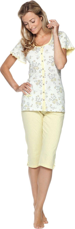 Deze leuke dames pyjama van Pastunette heeft een pyjamajasje met korte mouwen die geheel los te knopen is. De stof van het pyjamajasje is wit met een licht geel bloemenpatroon. Aan de mouwen zitten roesjes. De driekwart pyjamabroek is licht geel met grijze stipjes en heeft twee kleine strikjes aan de broekspijpen.