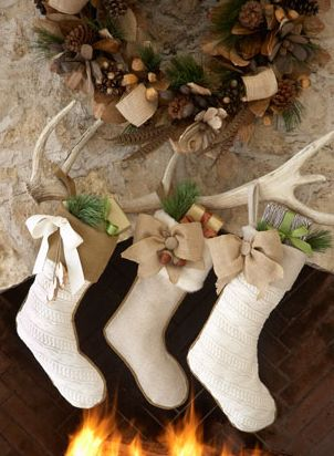 socks hanging from an antler, stockings by the fireplace, DIY decor