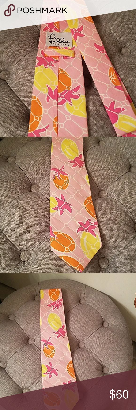 Lilly Pulitzer Colorful tie Lilly pulitzer cotton tie light pink with yellow and orange pineapples with darker pink tops. Have your Preppy gent match your cute dress or Lilly with his own tie! Perfect spring, summer, fraternity, rush, sorority function, tailgating tie to stand out! Lilly Pulitzer Accessories Ties