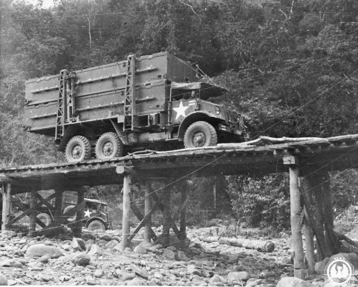 THE BRITISH ARMY IN BURMA 1944. A lorry loaded with pontoons arrives at the site of the 1,100ft floating bailey bridge over the Chindwin River, built after the capture of Kalewa, 2 December 1944.