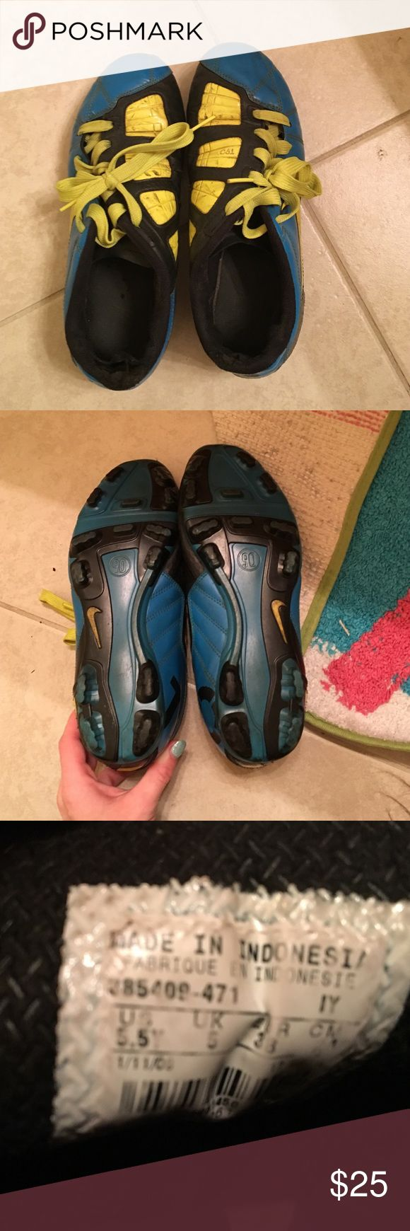 Soccer cleats size 5.5 Youth Nike cleats T90 blue and yellow, different laces that are better than ones that came with it wore a lot but still in good condition to play no holes, on left foot the back has a rip on the inside of fabric but doesn't affect shoe at all, right shoe on inside where big toe fits is worn down. All in all great cleats for kids Nike Shoes Athletic Shoes