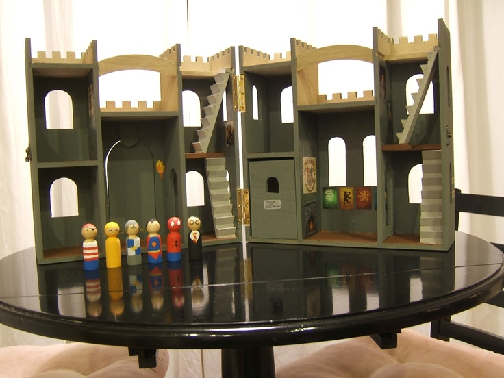 peg dolls with castle. I have this same castle from Michael's. My son loves it! I just painted it with gold spray paint and then I used sharpie markers to draw on the peg people. He has ninjas and superheroes living in his castle! Lol!