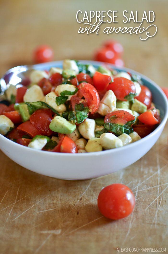 Caprese salad made with avocado, tomatoes, basil and mozzarella pearls.