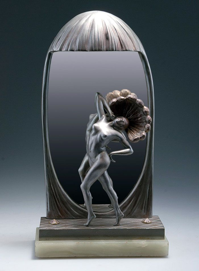 An Art Deco bronze figural lamp and mirror by M Bertin, France 1920s.