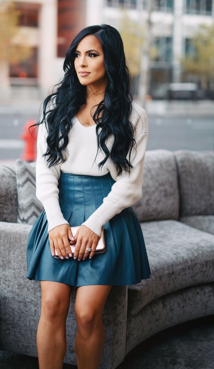 Cream and Teal. This Cream v neck sweater is my go to and I'm obsessed with a line skirts. This leather blue green skirt goes with some many things. You can dress it up for a date night or down for a movie night.