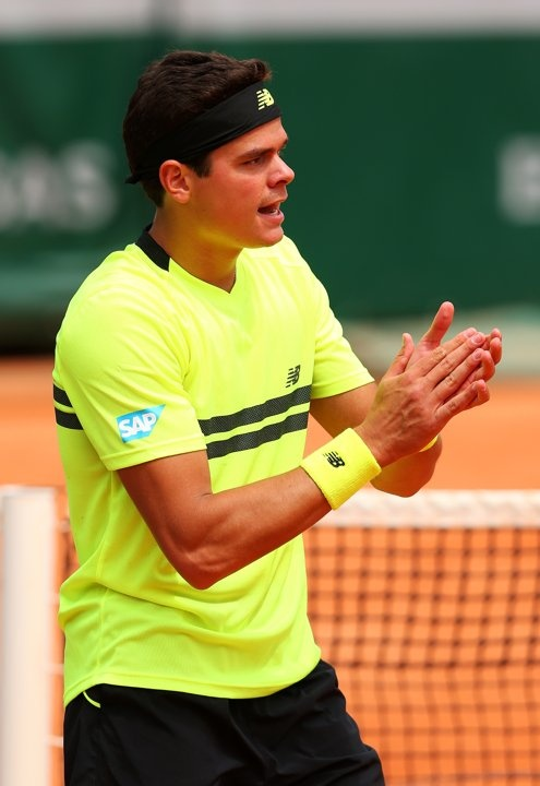 PARIS, FRANCE - MAY 26: Milos Raonic of Canada celebrates match point after his mens singles match against Xavier Malisse of Belgium on day one of the French Open at Roland Garros on May 26, 2013 in Paris, France. (Photo by Julian Finney/Getty Images)