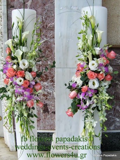 candles decorated in pastel colours with pink roses ,white lisianthus and orchids  by flowers papadakis tel 00302109426971 info@flowers4u.gr