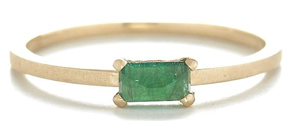 This 14k gold stacking stone ring features an emerald cut emerald set east to west. Pictured in: 14k yellow gold .44ct 5x3mm emerald 1.5mm wide Jennifer Dawes Design curates the most beautiful collect