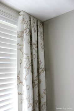 simple solution for drapes when the window goes all the way to the corner
