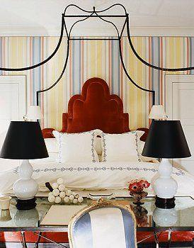 colorful stripes and velvet headboard in bedroom ~ Miles Redd design