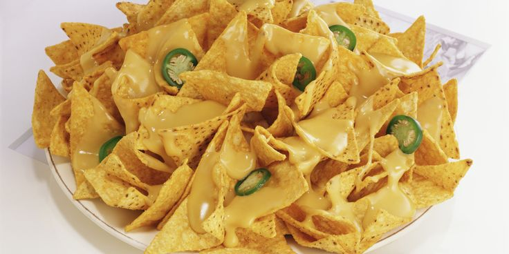 November 6 is National Nachos Day, and we can't think of a food more deserving of its own holiday. Cheesy, melty, crunchy goodness that you're allowed to eat with your hands?