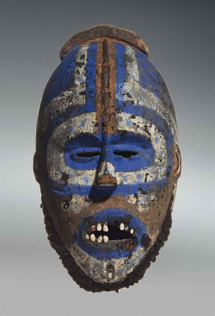 A GREBO MASK Maryland County, Area of Nyaake, Liberia wood with pigment, human teeth and hair Height: 20 in. (50.8 cm.)