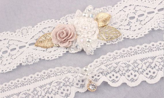 "*Gorgeous handmade flower motif lace garter set It's perfect for your special day!  *Size Please measure around thigh with a soft measuring tape and select your thigh measurement from drop down menu. Wedding garters are generally worn roughly 2-5"" above the knee to around mid-thigh. *Color& Materials -Off white elastic lace -hand beaded flower motif& gold leaf -Pearl, Rhinestone pieces -gold rhinestone charm -Crystal beads, pearls  **each of my creations is made of high quality materi..."