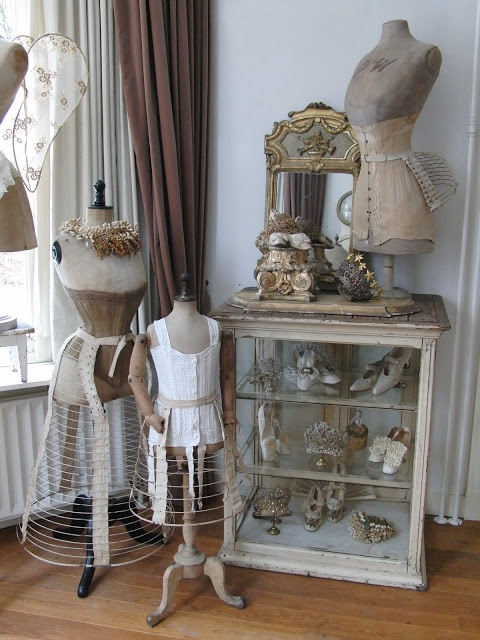 Various antique pieces--mismatched, like the edwardian corset with a bustle cage over it, but a charming effect as interior decor, none the less.