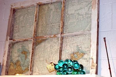 Nautical charts in an old window frame