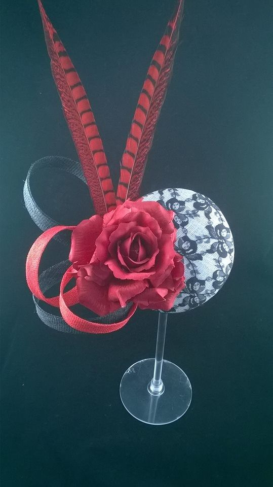Lace and roses in black white and red with red rooster feathers