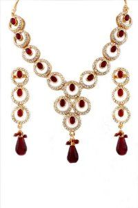 Gold lacquered necklace with maroon beads decorated with sparkling stones Sharnam Art. $15.00