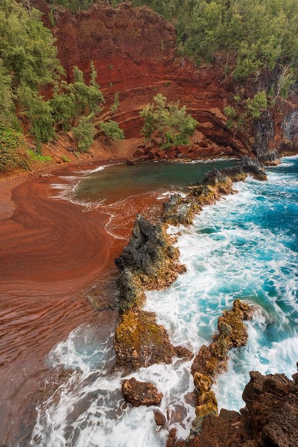 The Red Sand Beach in Maui, Hawaii. You'll need more than flip flops to get down there! It's in a remote, off the road place near Hana, that you have to hike down to. Beautiful beach and you will likely have this beach to yourself.