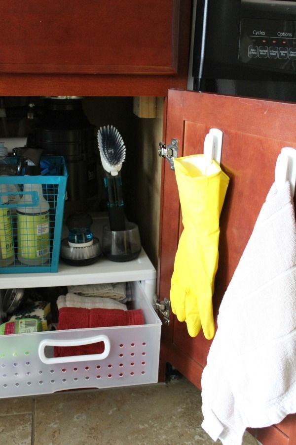 Kitchen organizing ideas for under the sink. This area gets so messy and items we bought get lost. Here's how to reign it all in so you can find things easily.