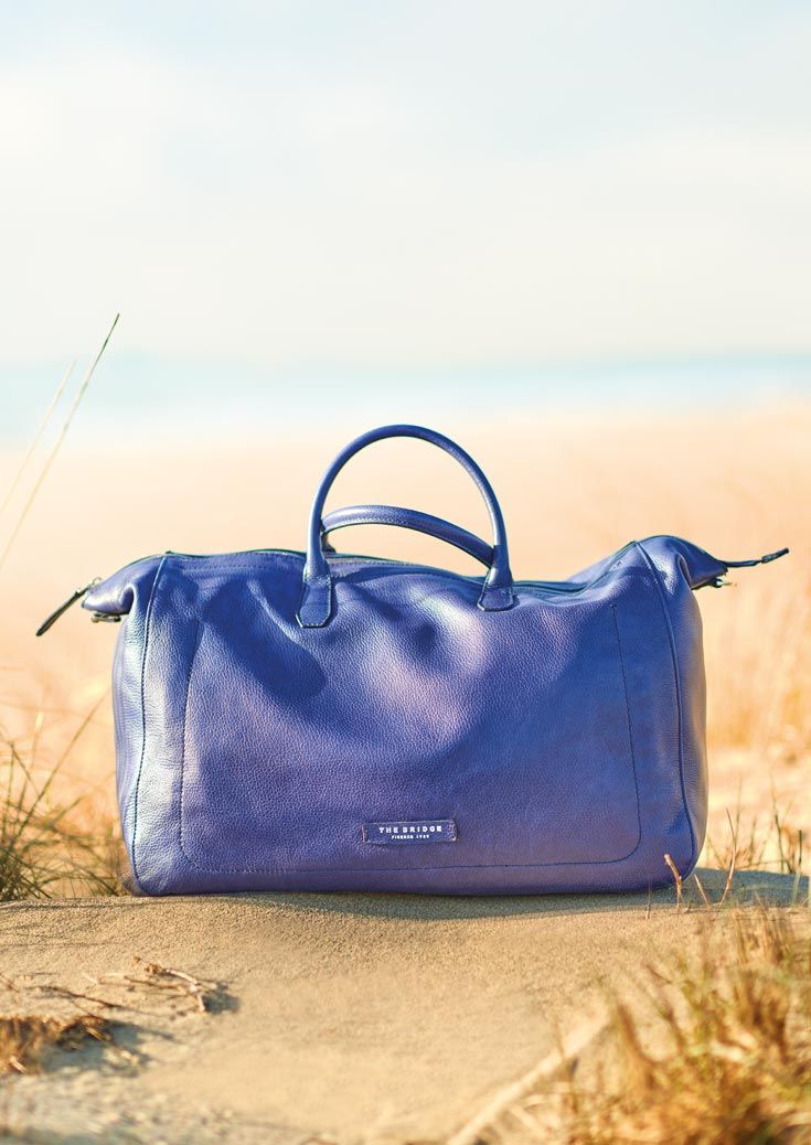 A shot from The Bridge ADV Campaign Spring/Summer 2016 features one of the leather travel bags from our latest collection. Its hip shade of blue makes this bag one of the season's must-haves for every style-conscious traveller. #TheBridgeBags   http://shop.thebridge.it/en-gb/catalog/index/accessories-and-travel?colm=Blu