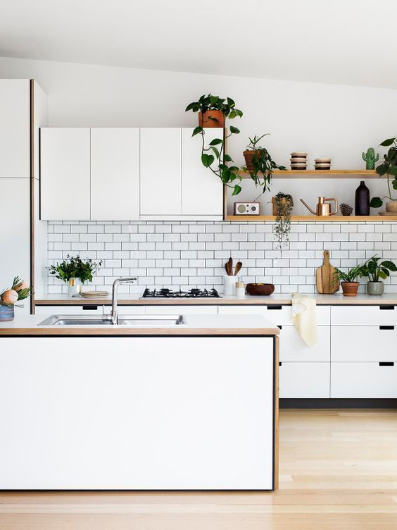 Kitchen, floating shelves and the dark grout add bit of interest to a white kitchen.