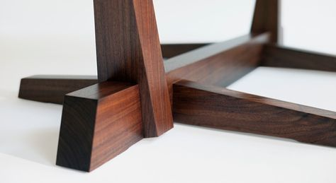 Furniture Conoid Dining Table by George Nakashima. The sculptural lines of the conoid base suit a more free-form table top and book-matched boards. Meticulous craftsmanship on the base (particularly the joinery) meets the comparatively free-form, live-edged table top.