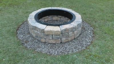 Just bought our first home and a fire pit was a requirement! Found this Kit and the price was perfect for us. You need to buy a few extra supplies if you want to follow the directions. I did not use the cement because I may want to move it later. I purchased 5 bags of pea gravel and it looks great! I dug out the sod, put down the gravel, then set the blocks on top. This had 3 rows but you can purchase more blocks to add and extra row if you like.