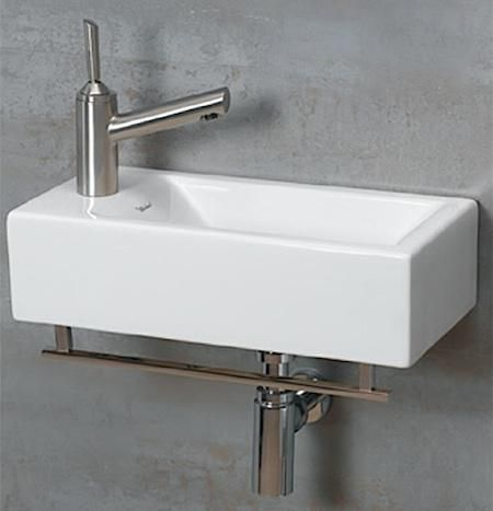 I love the clean square shape and the towel rack mounted on the bottom. Perfect for smaller bathrooms so typical of old homes.Wall-Mounted Guest Bath Sinks | Design Trends | Decorate | Home & Garden