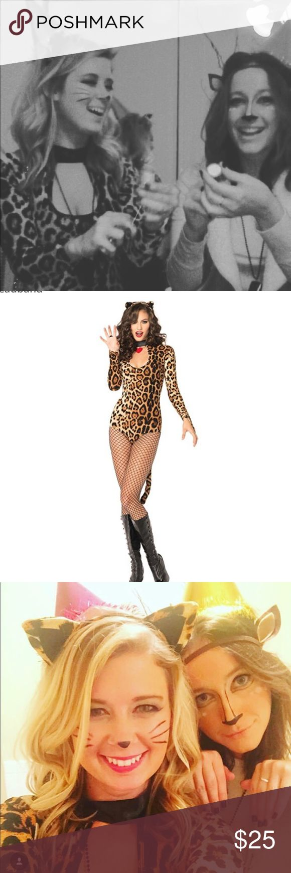 "Cheetah costume with ears It's an XS one piece cheetah costume (the leotard part) with choker neck and attached tail. It also comes with the cheetah ears. I wore this once on Halloween and it's in perfect condition and clean. The only thing different from the pic is that I cut off the little heart charm on the choker part (as seen in the second and third pic). Does not come with the fishnets.  Throw on a party hat and be a ""party animal""! I wore a black skirt over the leotard for a more…"