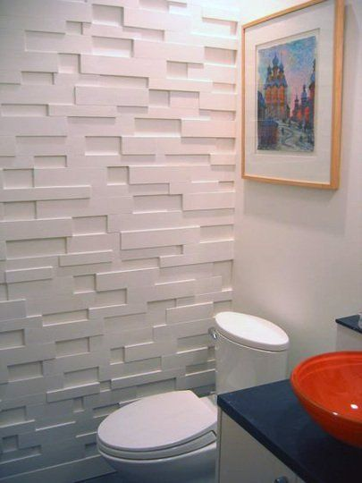 We've admired the look of textured wall treatments for a long time. Companies like modularArts and Inhabit have been selling modular wall paneling as an alternative to wallpaper, but from our experience, it's not an inexpensive application. Good thing someone's figured out how to get this look, on the cheap!