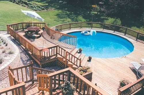 I love how this above ground pool has a deck built around it; makes it feel like a below ground pool!